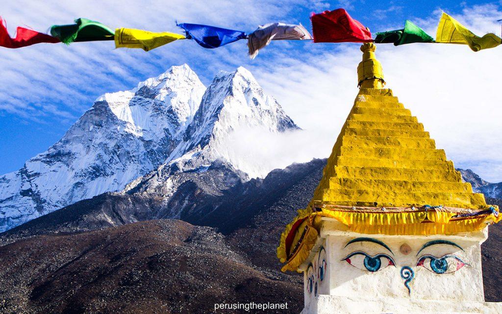 Buddha eyes stupa and mountains on EBC trek.