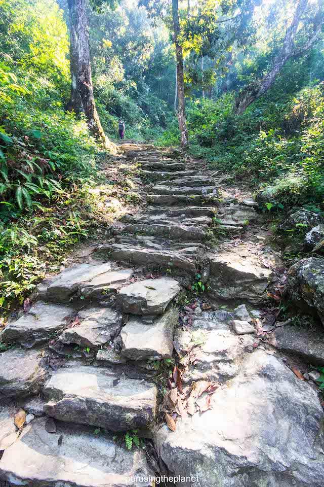 slippery steps on the trail to pokhara peace pagoda